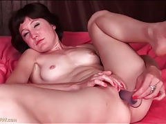 Shaved mom masturbates with a toy tubes
