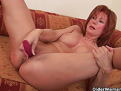 Sultry senior lady is toying her meaty pussy tubes