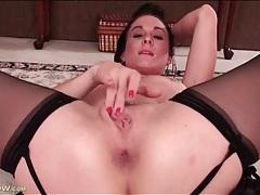 Brunette milf fingers her asshole in close up tubes