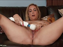 Chubby mature arouses pussy with a vibrator tubes