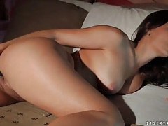 Brunette fucks her pretty pussy with a dildo tubes