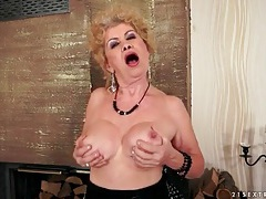 Granny in a slutty dress strips and masturbates tubes