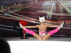 Busty ballerina in a mask has sexy tits tubes