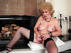 Granny masturbates hairy cunt with toys tubes