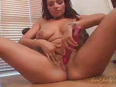 Mom strips off sexy skirt and toys her pussy tubes