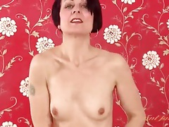 Milf unbuttons red cardigan and strips off jeans tubes