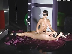 Two nude ballerinas help each other stretch tubes