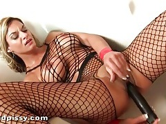 Babe in fishnets masturbates pussy in the bathtub tubes