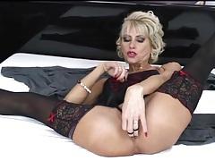 Glamorous mature blonde in lingerie masturbates tubes