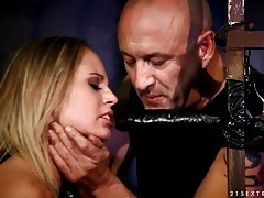 Submissive blonde gags on big dildo in prison tubes