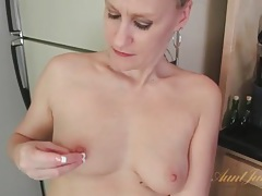 Cute housewife masturbates in her kitchen tubes