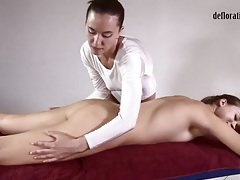 Girl in white teddy gives a sexy massage tubes