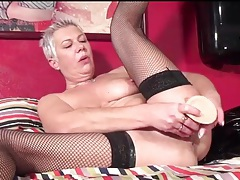 Masturbating mature wears black fishnets tubes