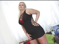Chubby blonde girl models her red fishnets tubes