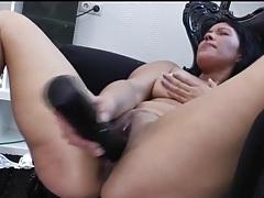 Solo brunette fucks a big black dildo tubes