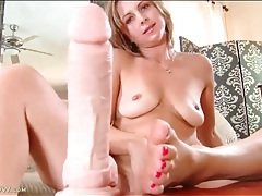 Brunette gives footjob to a lifelike dildo tubes