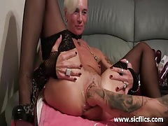 Brutally fisting her massive snatch till it squirts tubes