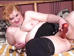 Fat redhead masturbates in black stockings tubes