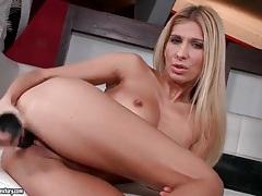 Blonde fucks and blows black dildo tubes