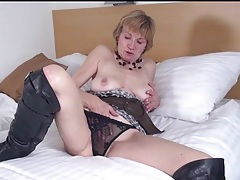 Knee high leather boots look sexy on mature tubes