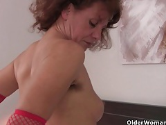 Hot granny in stockings rubs her hairy pussy tubes