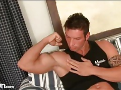 Muscular guy gets naked and kisses his biceps tubes