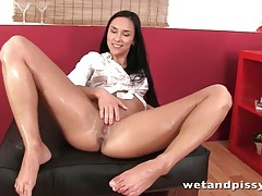 Brunette is all wet with her hot piss tubes