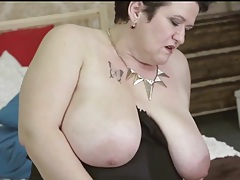 Fat girl in a black corset fingers her box tubes
