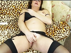 Cute brunette mom masturbates in stockings tubes