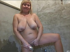 Curvy mature showers and fondles her big tits tubes