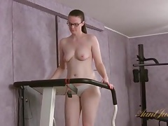 Nerd with shaved pussy walks treadmill and strips tubes