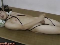 Smooth asian boy slave making cumshot tubes
