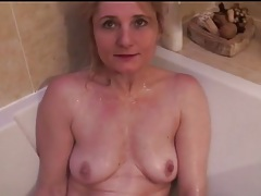 Slender mature with small tits takes a bath tubes