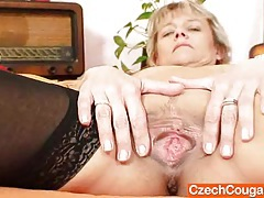 Good-looking domina wife performs strange masturbation tubes