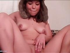 Cute brunette in fuzzy hat masturbates cunt tubes