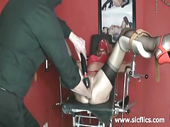 Fisting and vacuum pumping her massive snatch in bondage tubes