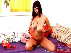 Dominno strips off red lingerie and fondles body tubes