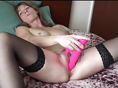 Mature with a gorgeous body toys her pussy tubes