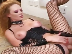 Redhead has sex in leather and fishnet stockings tubes