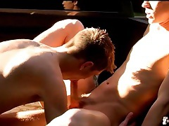 Guys in a truck bed suck toes and balls tubes