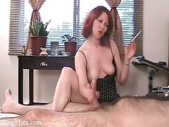 Cigarette in her mouth as she gives a handjob tubes