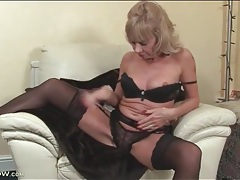 Mature blonde cathy oakley strips to black lingerie tubes