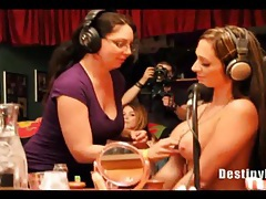 Ladies suck on tits on a radio show tubes