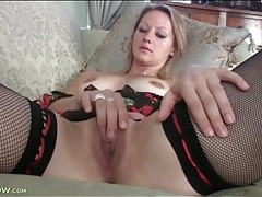 Pretty mom in black fishnet stockings masturbates tubes