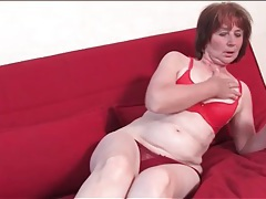 Old lady models her red panties for you tubes