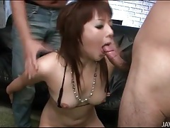 Slut on her knees sucks two dicks tubes