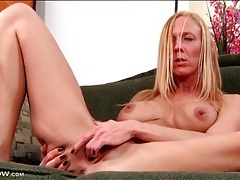 Finger fucking milf plays with her fake tits tubes