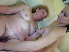 Old dirty granny and her favorite toy play in the bed tubes