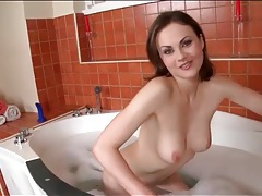 Cutie strips off pink bathrobe and takes a bath tubes