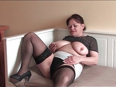 Big belly mature in stockings rubs hairy cunt tubes